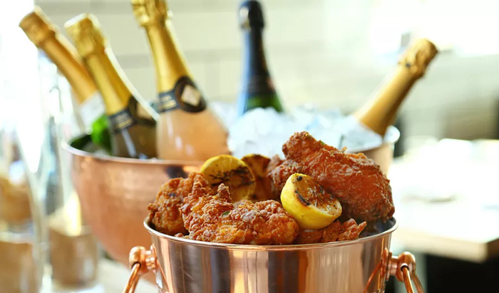 Copper buckets with champagne and fried chicken